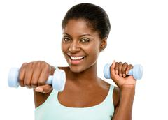 closeup african american woman exercising white background - stock photo