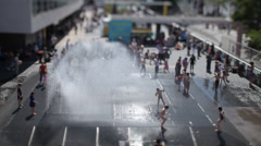 Tilt/shift filming of Festival Hall fountains in London - stock footage