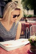 at a sidewalk cafe - stock photo