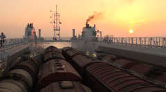 Cargo ship sunset trains NATO Afghanistan supply route Caspian Sea Stock Footage