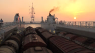 Stock Video Footage of Cargo ship, sunset, trains, NATO, Afghanistan, supply route, Caspian Sea