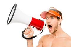closeup of crazy lifeguard man shouting in megaphone on white - stock photo