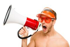 Closeup of crazy lifeguard man shouting in megaphone on white Stock Photos