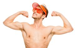 closeup of attractive young man flexing bicep muscles on white background - stock photo