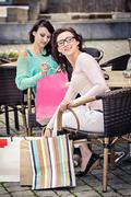 two young women in a street cafe - stock photo