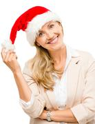 Happy mature woman wearing santa hat for christmas isolated on white Stock Photos