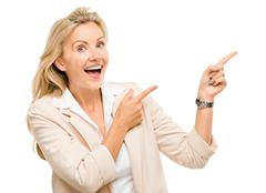 Mature business woman pointing empty copy space smiling isolated on white bac Stock Photos