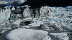 Aerial view of moraine covered icebergs from Knik Glacier, Alaska, USA Stock Footage