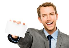 Businessman holding empty white placard showing copy space Stock Photos