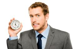 businessman holding stop watch clock white background - stock photo