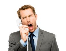 Customer service agent shouting phone white background Stock Photos