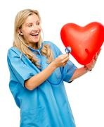 Funny nurse woman listening heart isolated on white background Stock Photos