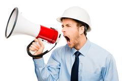 Businessman shouting megaphone white background Stock Photos