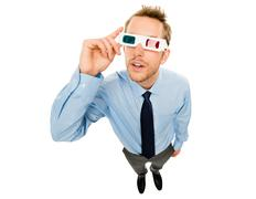 businessman wearing 3d glasses isolated on white background - stock photo