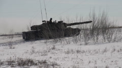 Military, Leopard tank maneuvering through snow Stock Footage