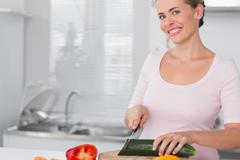 Stock Photo of Pretty woman cutting vegetables