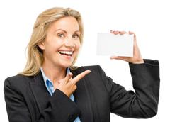 Mature business woman holding white placard pointing Stock Photos