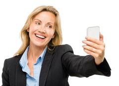 Video messaging mobile phone woman happy mature isolated on white Stock Photos