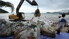 OIL SPILL DISASTER BACK HOE HYDRAULIC EXCAVATOR Stock Footage