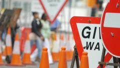 Roadworks, people and cars. - stock footage