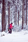 with snowshoes in a winter forest - stock photo