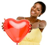Stock Photo of cute african american woman holding red balloon heart valentines day isolated