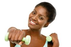 Healthy african american woman excercising with dumbbells isolated on white b Stock Photos