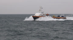 Fast industrial vessel on its way to oil rig, on Caspian Sea Stock Footage