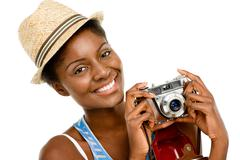 happy african american woman tourist holding vintage camera isolated on white - stock photo
