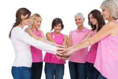 Cheerful women posing in circle wearing pink for breast cancer Stock Photos