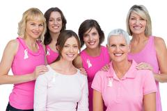 Smiling women posing and wearing pink for breast cancer Stock Photos