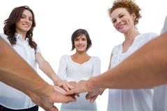 Cheerful models joining hands in a circle Stock Photos