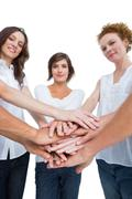 Peaceful women joining hands in a circle Stock Photos