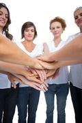 Relaxed models joining hands in a circle Stock Photos