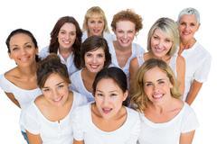 Cheerful female models smiling at camera Stock Photos