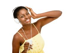 beautiful african american woman dancing listening to music isolated white ba - stock photo