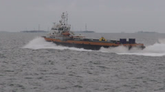 Oil equipment vessel underway to oil rigs, on the Caspian Sea - stock footage