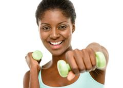 healthy african american woman exercising using dumbells isolated on white ba - stock photo