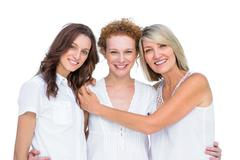 Cheerful beautiful models posing hugging each other - stock photo