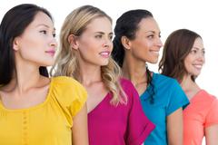 Cheerful models posing and looking away - stock photo