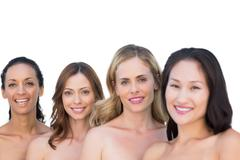 Stock Photo of Smiling nude models posing in a line with brunette on background