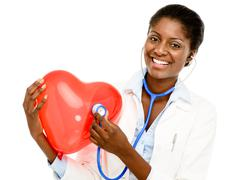 happy african american trusted nurse holding red heart isolated on white back - stock photo