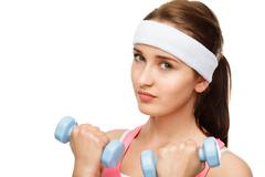 closeup portrait healthy athletic woman lifting weights - stock photo