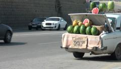 Watermelons for sale in trunk of old Lada in Baku Stock Footage