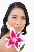 Sensual natural model posing with lily - stock photo