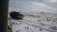 Stock Video Footage of military, LAV3 armoured fighting vehicle on the move fast