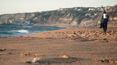 BEACH FISHERMAN WALKIN Stock Footage