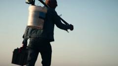 BEACH FISHERMAN WALKING Stock Footage