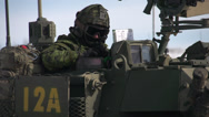 Stock Video Footage of crew commander on LAV3 armoured fighting vehicle, close up