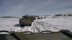 Military, POV rear veiw of moving line of LAV3 Stock Footage